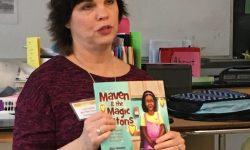 Mimi reads Maven in classroom